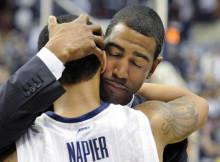 Coach Kevin Ollie hugs Shabazz Napier | Cloe Poisson, Hartford Courant