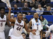 UConn's starters celebrate a bucket by walk-on Terrance Ditimi (John Woike | Hartford Courant)
