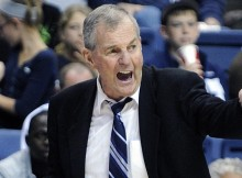 IFLE - In this Nov. 14, 2011 file photo, Connecticut coach Jim Calhoun shouts to a player during the second half of Connecticut's 78-66 victory over Wagner in an NCAA college basketball game in Storrs, Conn. Calhoun says he decided not to retire after last year's national championship in large part because he wanted to see through the NCAA sanctions leveled on him and his program for recruiting violations. (AP Photo/Fred Beckham, File)